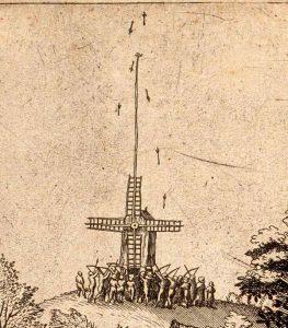 Detail: Der Vogel ist an einer langen Stange auf der Windmühle befestigt.